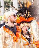 LIMASSOL, CYPRUS - FEBRUARY 26: Carnivalists in a silver cylinder hats joyfully follow the Limassol Municipality Band Stock Images