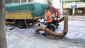 LIMASSOL, CYPRUS - FEBRUARY 26: Street cleaner with industrial vacuum cleaner stock video footage