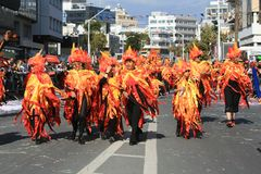 People in carnival costumes walking along a street stock photos