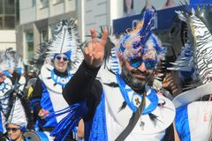 Man in carnival costume with blue irokez stock image