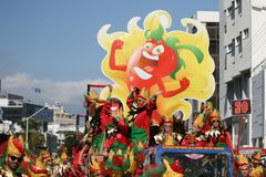 People in carnival costumes riding a float royalty free stock images