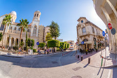 LIMASSOL, CYPRUS - MARCH 18, 2016: Tourists exploring the old to Stock Images