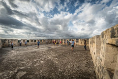 LIMASSOL, CYPRUS - October 25, 2016: Tourists admiring the surroundings from the roof of Kolossi castle. Limassol District, Cyprus Stock Photography