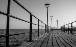 Limassol Piers V. A black and white picture of a pier in the grand promenade of Limassol stock photo