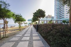 Limassol seafront promenade, Cyprus. A summer view of the beach front in Limassol city in Cyprus in Neapoli area, near the Olympic Residence. A view of the stock image