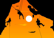 Сlimbing. Extreme sport - сlimbing at sunset Royalty Free Stock Image