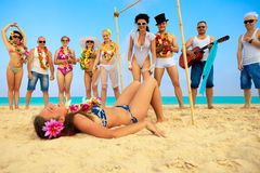 Limbo. Vacationers have fun doing the limbo. One from them falling down Royalty Free Stock Photos
