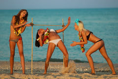 Limbo. Vacationers have fun doing the limbo Royalty Free Stock Image
