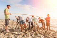 Limbo at Beach. Friends Dancing Limbo at Beach Stock Images