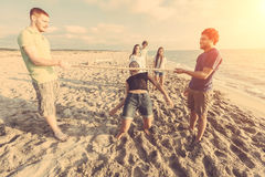 Limbo at Beach. Friends Dancing Limbo at Beach Royalty Free Stock Images