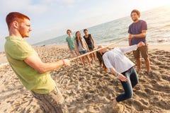 Limbo at Beach. Friends Dancing Limbo at Beach Royalty Free Stock Photos