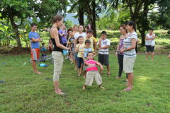 Limbo dance. Sports organized by Canadian students for children from Costa Rica Royalty Free Stock Photography