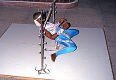 Limbo dancer, Tobago. Man limbo dancing under a low bar, Tobago, Trinidad and Tobago, Caribbean Stock Photography