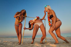 Limbo. Vacationers have fun doing the limbo Royalty Free Stock Photography