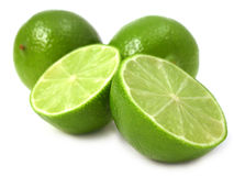 Lime. Fresh cut green lime on a plain background Stock Images