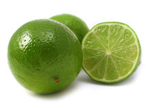 Lime. Fresh cut green lime on a plain background Royalty Free Stock Photography