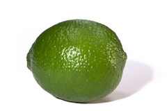 Lime. Green lime isolated on white Royalty Free Stock Image