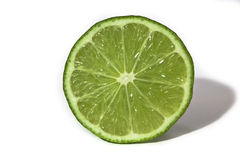 Lime. Green lime slice isolated on white Royalty Free Stock Images