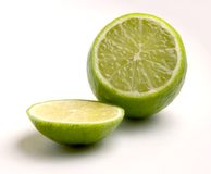 Lime. Cutted into two pieces Royalty Free Stock Photo