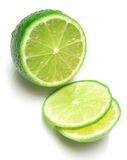 Lime 3. The tropical fruit known as lime, cut across. The image is isolated on white. Shallow DOF. Close-up Royalty Free Stock Photo
