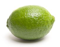 A lime. Fresh whole lime. Clean and simple. Clipping path included Royalty Free Stock Photos