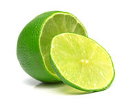 Lime. The tropical fruit known as lime, cut across. The image is isolated on white. Shallow DOF. Close-up Royalty Free Stock Photo