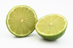 Lime. A lime fruit cut in half and glistening with water Stock Photos