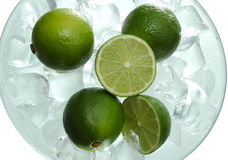 Lime. In saucer with ice Royalty Free Stock Photography