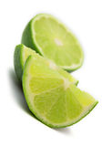 Lime. The tropical fruit known as lime, cut across. The image is isolated on white. Shallow DOF. Close-up Royalty Free Stock Photos