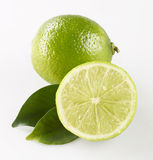 Lime. Whole lime and half a lime with leaves Royalty Free Stock Photo