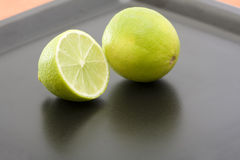 Lime. Sliced lime at a black dinner plate Stock Photo