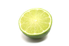 Lime. A green shiny sliced lime Royalty Free Stock Photos