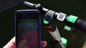 Lime app and electric scooter handlebars stock photo