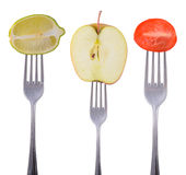 Lime, apple and tomato on a fork Royalty Free Stock Photography