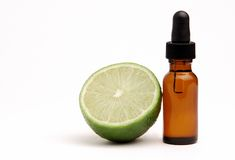 Lime Aromatherapy. Bottle of Lime Essential Oil with a lime Stock Image