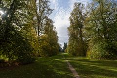 Lime Avenue path with house at Nowton Park in autumn. Lime Avenue path with house in aun at Nowton Park, Bury St Edmunds, Suffolk, UK stock photo