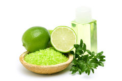 Lime bath salt, oil bath and some fresh fruit Royalty Free Stock Image