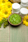 Lime bath salt and yellow flowers Royalty Free Stock Photography
