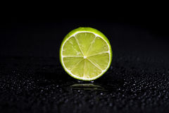 Lime on a black background Royalty Free Stock Images