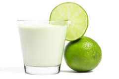 Lime blade on a milkshake and lime aside Royalty Free Stock Photography
