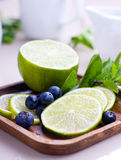 Lime and blueberries Stock Photos