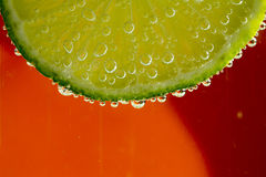 Lime in the bubbles Stock Image