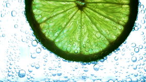 Lime with bubbles stock video footage