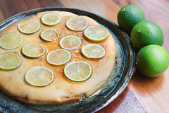 Lime cake. Golden lime cake covered with lime syrup and thin lime slices Stock Images