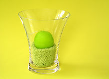 Lime Candle. Lime colored Candle in a glass vase stock photo