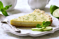 Lime cheesecake with mint sugar. Stock Photo