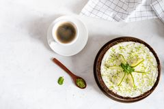 Lime cheesecake with peppermint. Cheesecake with cup of coffee on white background. Top view, copy space royalty free stock images
