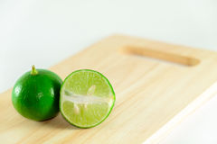 Lime on chopping block Stock Images