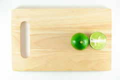 Lime on chopping block Royalty Free Stock Image