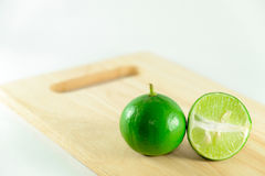 Lime on chopping block Stock Image